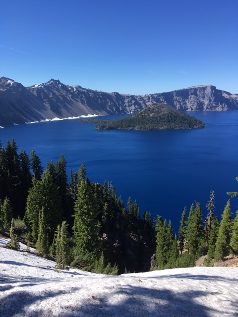 Crater Lake and Wizard Island with snow on the ground