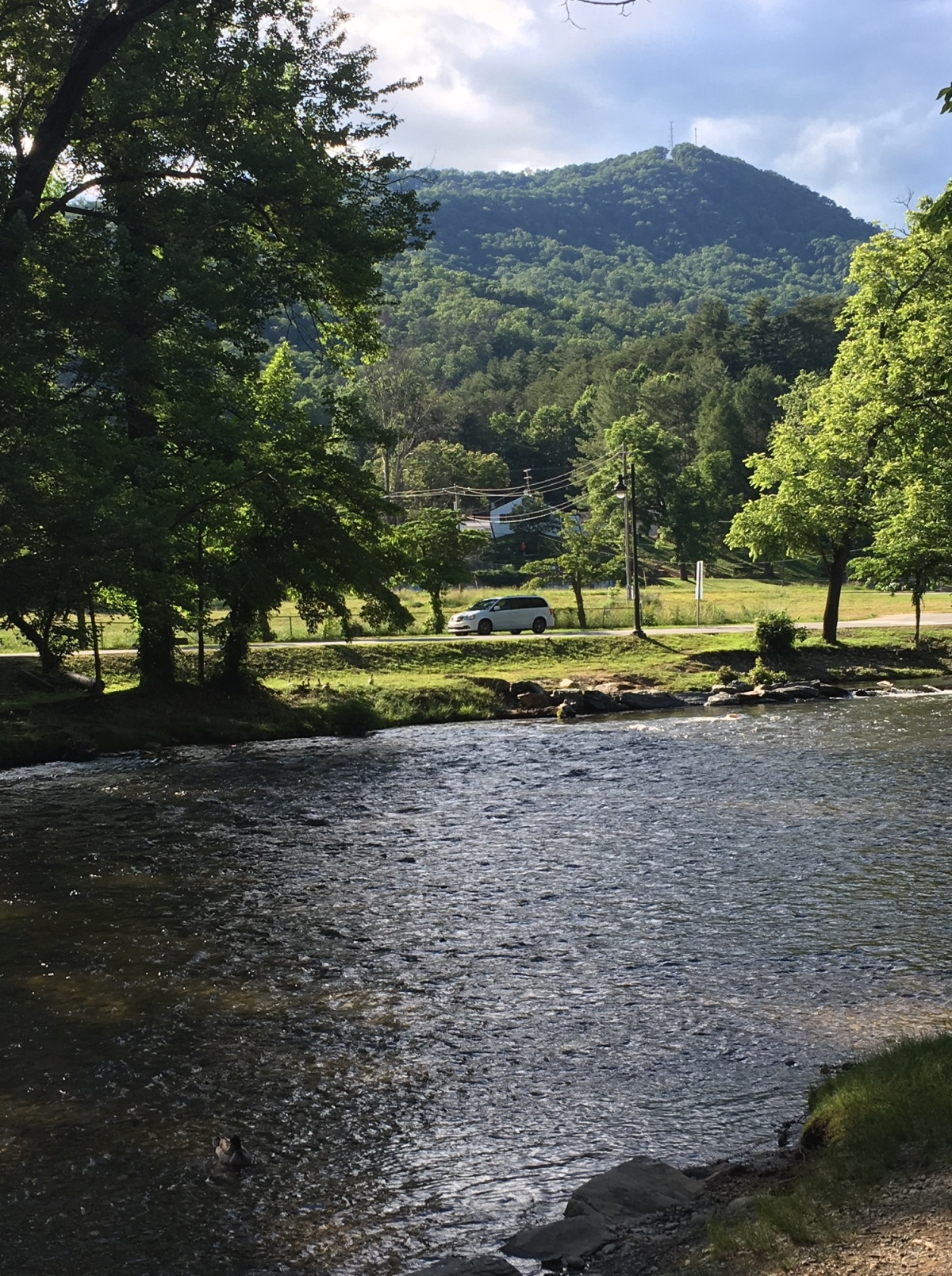 The river with the Smoky Mountains in the background