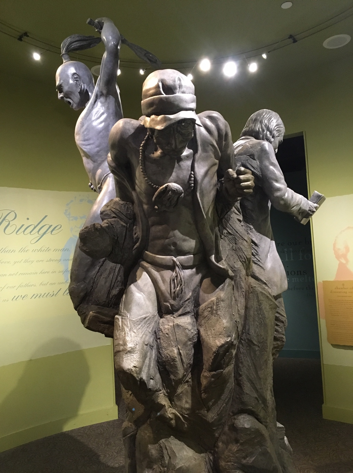 Three descenting voices statue